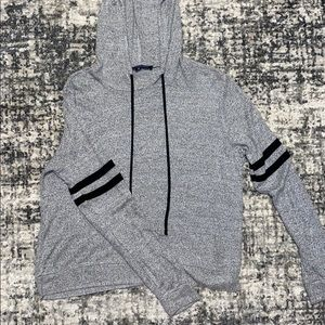 a gray shirt with a hood
